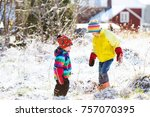 kids playing with snow.... | Shutterstock . vector #757070395