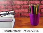 colored pencils on wooden desk... | Shutterstock . vector #757077316