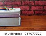 colored pencils on wooden desk... | Shutterstock . vector #757077322