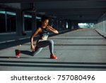 young woman exercise outdoors | Shutterstock . vector #757080496