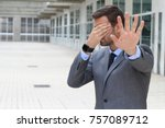 Small photo of Denial concept with businessman covering his eyes
