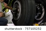Stock photo aircraft brake repair close up of airplane wheel and shaft huge airplane tyre with shaft and 757105252