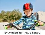kid with bike and helmet smiles ... | Shutterstock . vector #757155592
