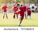 boy kicking football on the... | Shutterstock . vector #757286815