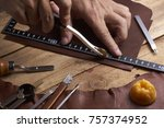man working with leather | Shutterstock . vector #757374952