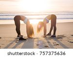 two women stretching on beach... | Shutterstock . vector #757375636