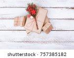 christmas present on white wood ...   Shutterstock . vector #757385182