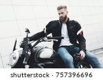 a young guy with a beard sits... | Shutterstock . vector #757396696