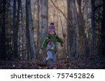 a little boy is jumping and... | Shutterstock . vector #757452826