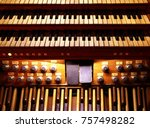 Small photo of Detail of pipe organ console (an equipment for playing music) 3 hand-keyboards, 1 Pedal keyboard and many coupling buttons.