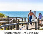 surfer and his surfboard. | Shutterstock . vector #757546132
