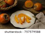 fresh persimmon. slices of...   Shutterstock . vector #757579588