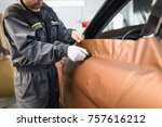car wrapping specialist putting ... | Shutterstock . vector #757616212