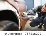 car wrapping specialist putting ... | Shutterstock . vector #757616272