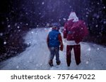 a little boy is walking with... | Shutterstock . vector #757647022
