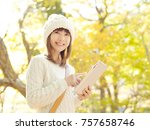 smiling asian woman   Shutterstock . vector #757658746