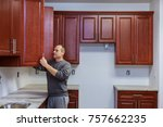 Stock photo carpenter working on new kitchen in home cabinets improvement kitchen remodel 757662235