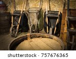 Wheelbarrows stand at the ready in the lower level of an 1850's barn.  DuPage County, Illinois. - stock photo