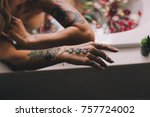 woman smoking weed in a bath   Shutterstock . vector #757724002