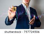 golden bitcoin in a man hand ... | Shutterstock . vector #757724506