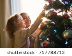 mother and daughter decorate a... | Shutterstock . vector #757788712