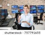 female stock trader working in... | Shutterstock . vector #757791655