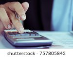 Small photo of business people who use a calculator with financial concepts, spreadsheet data, business people use their fingers to compute calculations for sales graphs and more storage space.