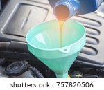 close up pouring oil to car... | Shutterstock . vector #757820506