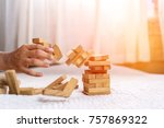 Small photo of Hand of pulling wood block fail on building tower at home and drape change, choice business risking dangerous project plan failure construction,Selective block wooden