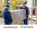two young male worker in blue... | Shutterstock . vector #757874506
