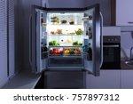open refrigerator full of juice ... | Shutterstock . vector #757897312