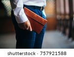 the business man with a purse... | Shutterstock . vector #757921588