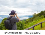 a man is taking a photo on the... | Shutterstock . vector #757931392