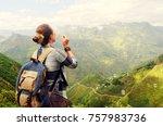 playful traveller woman blowing ... | Shutterstock . vector #757983736