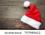 Red Santa Hat On Grey Wooden...