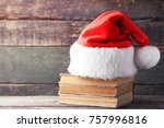 red santa hat with old books on ... | Shutterstock . vector #757996816