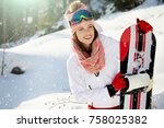 sexy snowboarder woman outdoors.... | Shutterstock . vector #758025382