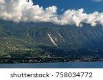 clouds touching mountains near... | Shutterstock . vector #758034772