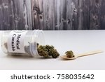 Small photo of Pot of medicinal marijuana buds administered in spoon