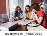 three smiling female college... | Shutterstock . vector #758070982