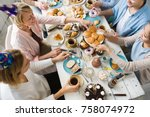 one of females by dinner table... | Shutterstock . vector #758074972