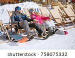 male and female skiers enjoy in ... | Shutterstock . vector #758075332