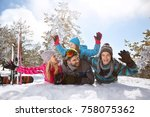 happy family having fun on snow ... | Shutterstock . vector #758075362