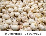 garlic on the counter on the... | Shutterstock . vector #758079826
