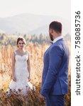 beautiful bride and groom in... | Shutterstock . vector #758085736