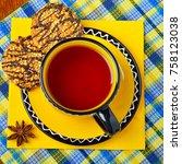 cup of tea with dessert served... | Shutterstock . vector #758123038