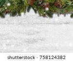 fir branches on wooden... | Shutterstock . vector #758124382