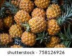 selling fresh pineapple in the... | Shutterstock . vector #758126926