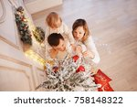 happy family placing christmas... | Shutterstock . vector #758148322