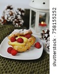 Small photo of Christmas Eclair with Raspberries